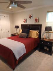 Your room is on the first level of the house and includes a queen bed, closet space, desk, and ceiling fan.