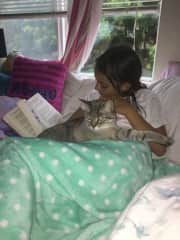 My daughter and Kiki reading and cuddling.