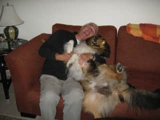 My husband when house/pet sitting for a friend - having fun with Rough Collie, Billy