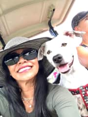 Lola on golf cart while visiting friends