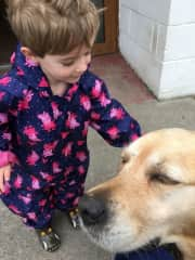 Abigail and doggy both very happy together