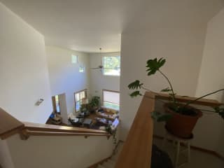 view of lofted living room from the top of the stairs