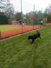 Mark doing his fav thing - playing football - and Charlie the dog is equally excited