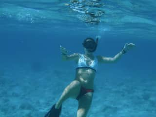 I love to travel! This is a picture of me snorkeling in Turks and Caicos last winter.