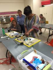 Phyllis teaching a stained glass class