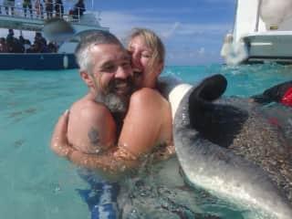 Hugging a stingray, Cayman Islands