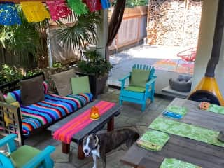 Outside seating areas, fireplace and table