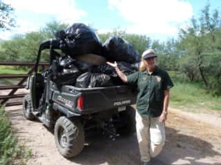 Here I am with all the trash we collected on National Public Lands Day at Tumacacori National Historical Park, where I volunteered in 2016 and 2017.