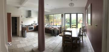 Open plan kitchen and dining area with access to garden.