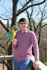 Me and Indigo, my family's blue throated macaw which we rescued.