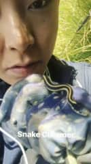 Me at work charming a little snake.