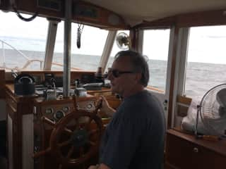 Art at the helm of our Grand Banks in Chesapeake Bay