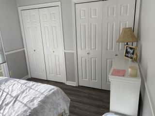Left closet is empty and available. Right closet holds linens.