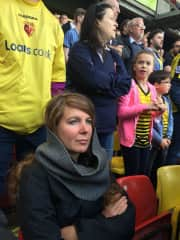 Jill kinda enjoying a Watford football game.