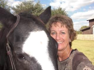 Karen loving on one of the horses