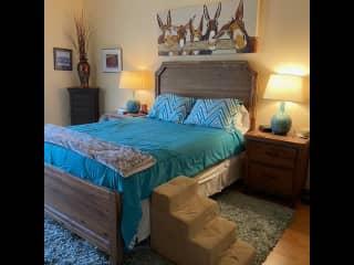 Master bedroom w/TV, walk-in closet, full bath w/bidet & garden tub and sliding door to patio and hot tub.