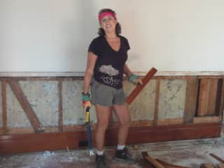 Tearing out beadboard from an 1892 house before demolition
