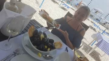 Eating delicious seafood at the beach