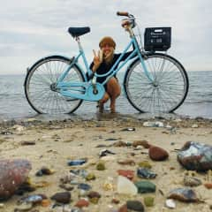 I love to cycle and repair bikes - here I am after a recent 600 km bicycle trip across the Netherlands and Germany!