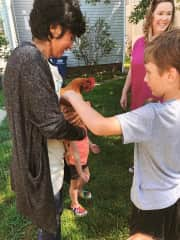 Teaching how to care for chickens to kids with my hen Nora