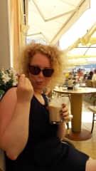 Me - enjoying an ice coffee on a trip
