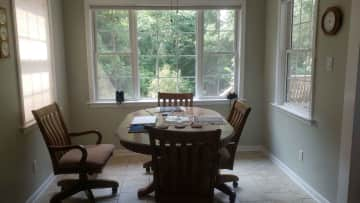 The dining area between the kitchen and living room