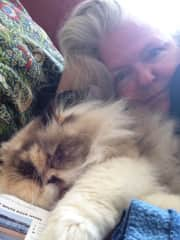 Me on a lazy day with Pumpkin from my Eastbourne Housesit in 2018