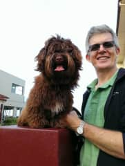 Craig with one of our dogs, Luis the Havanese.