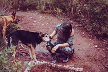 Meryem on a hike with Tala + Dobi