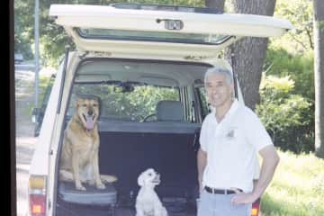 Chris with Fudge, our rescue dog and Chippy, our Maltese poodle  on the way to the forest for a daily walk