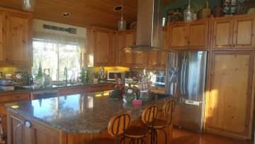 Kitchen w/Large Island, propane stove/oven, dishwasher, microwave