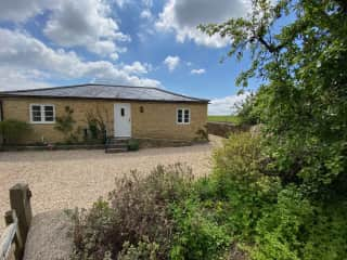 At the end of the garden is this small cottage where you would stay.  Its has a double bedroom and a main sitting room / kitchen.