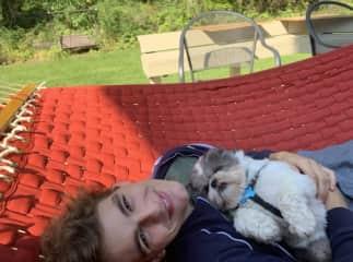 Yasha with his family's pup, Apollo!