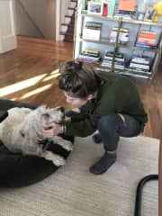 Offering kisses to the oldest resident of the home.
