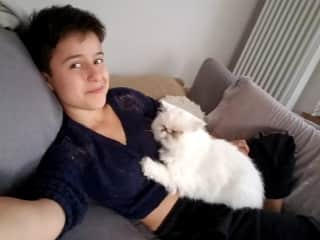 This is me with a cat I was house sitting for two weeks who LOVED me. He would sleep on my my pillow next to my head and when I told the owners that they said he hadn't done it in years.