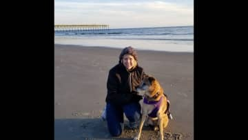 At my home Oak Island with my 11 year-old dog visiting for the weekend.  I am currently living with my sister as I have sold my home in Charlotte NC after 15 years there (empty nester now).