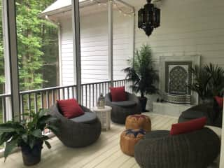 Moroccan themed seating area on screened porch