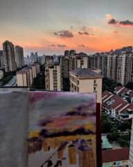 Painting on my balcony last summer.