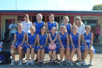Linda coaching the girls Netball
