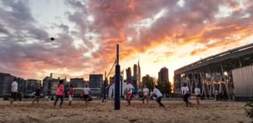 Nothing like a volleyball game with the NYC skyline in the background!