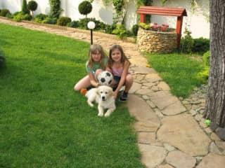 Little Adrianna with her little golden puppy.