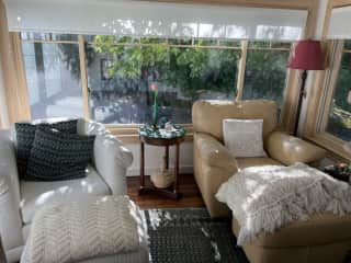 sunroom- wonderful space to sit and write or contemplate life!