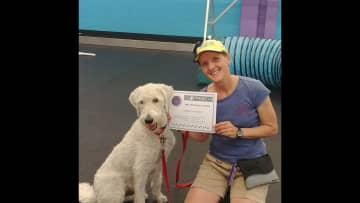 My labradoodle and I with one of our agility certificages