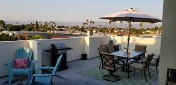Our rooftop patio is completely private - no sharing with neighbors! It has a gorgeous view of the mountains in the background.