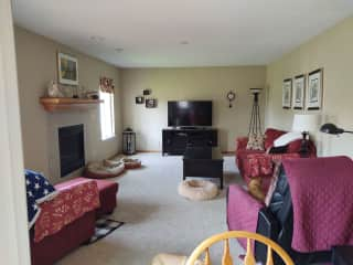 Family room adjacent to the kitchen.  We have Mediacom cable plus Netflix.  The room looks over the back yard.