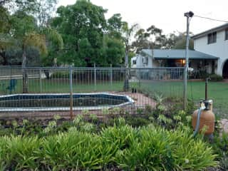 Front yard and BBQ area. Note, pool is not operational - it is now a 'bush-pond'