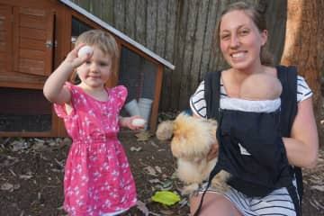 Megan and Elena with one of our chickens.