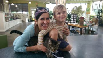 Kelley and Rowan with the cat (Olive) at the nursery down the street
