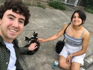 Posing for photos with a street cat!