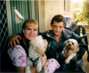 Me and my partner some years ago with our dogs, poodle cross and cavalier cross